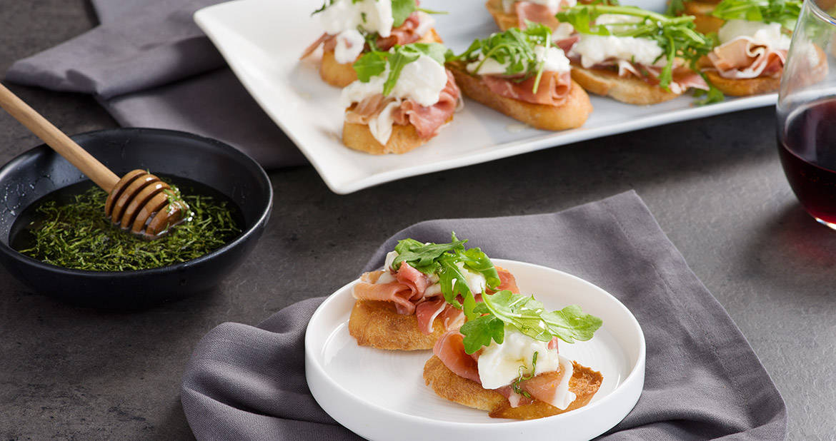 Burrata and Prosciutto Crostini with Basil-Infused Honey