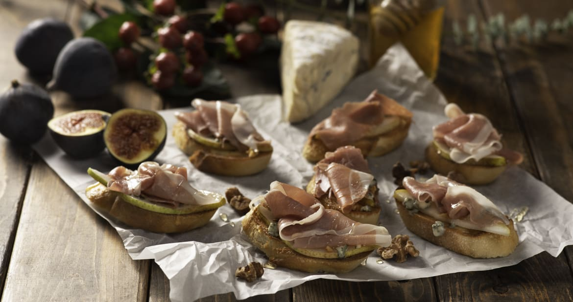Pear and Blue Cheese Melts with Prosciutto and Walnuts
