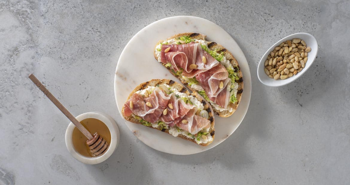 Ricotta Toasts with Caramelized Brussels Sprouts and Prosciutto